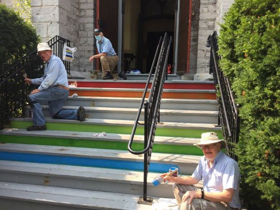 Fixers painting the front steps